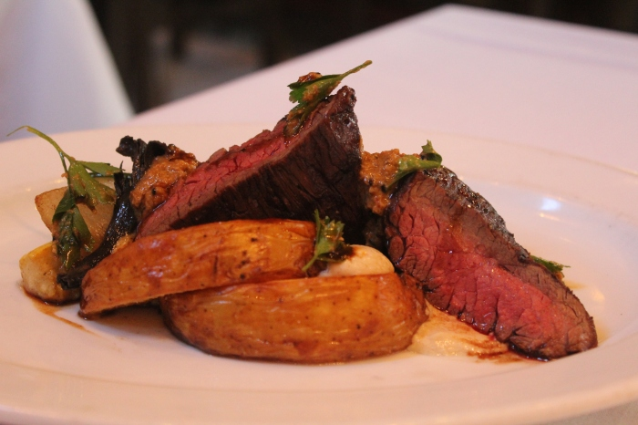 Hanger Steak with Tahni Roasted Potatoes at Emeril's