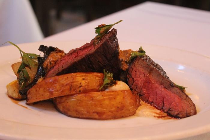 Hanger Steak with Tahni Roasted Potatoes at Emeril's